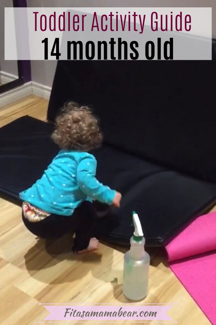 Pinterest image with text: toddler in blue shirt and black pants cleaning gym mats as activities for 14-month-old