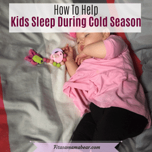 Pinterest image with text: toddler in pink shirt and black pants sleeping on bed