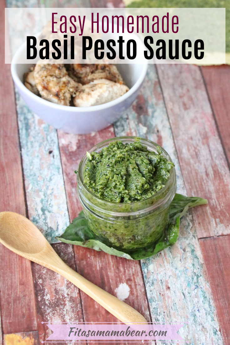 Pinterest image with text: homemade basil pesto sauce in a mason jar with a wooden spoon and chicken around it