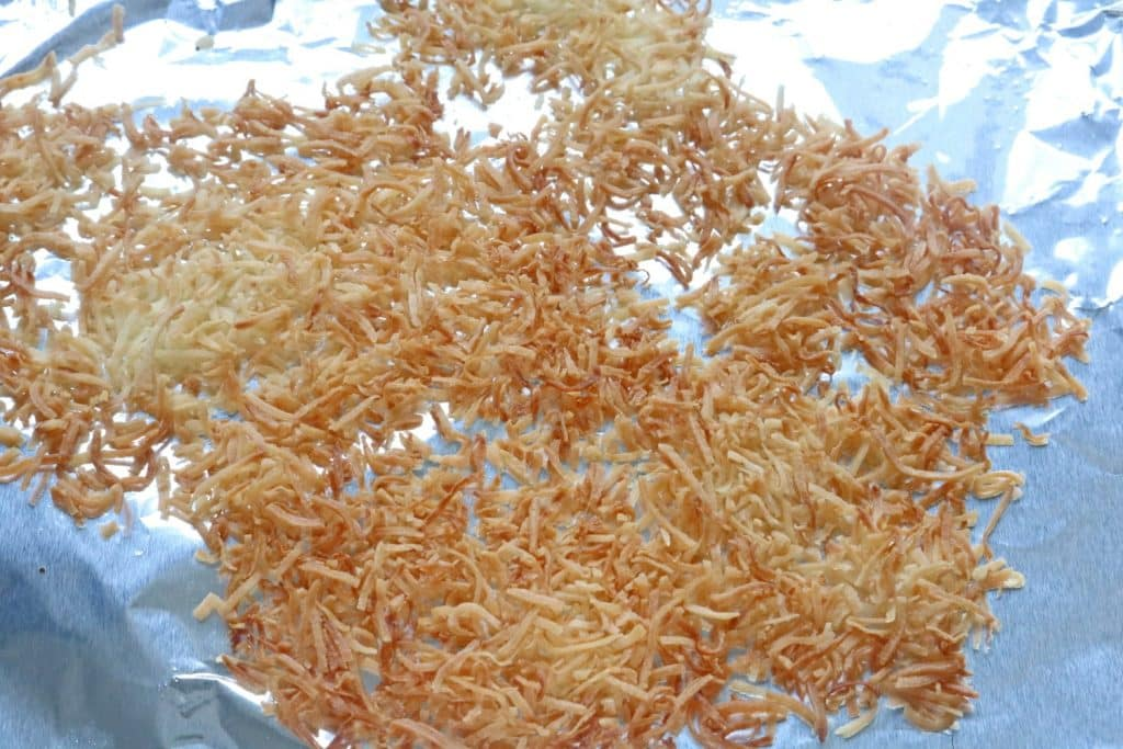 Toasted coconut on a baking tray lined with tinfoil