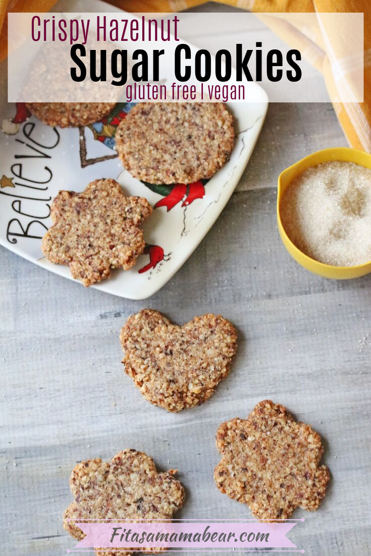 Pinterest image with text: crispy sugar cookies on a grey table and three on a christmas plate with a yellow bowl of sugar with text about gluten-free sugar cookie recipe
