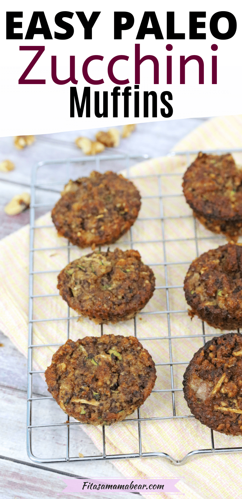 Pinterest image with text: Gluten-free zucchini muffins on a cooling rack over a peach linen with walnuts around it