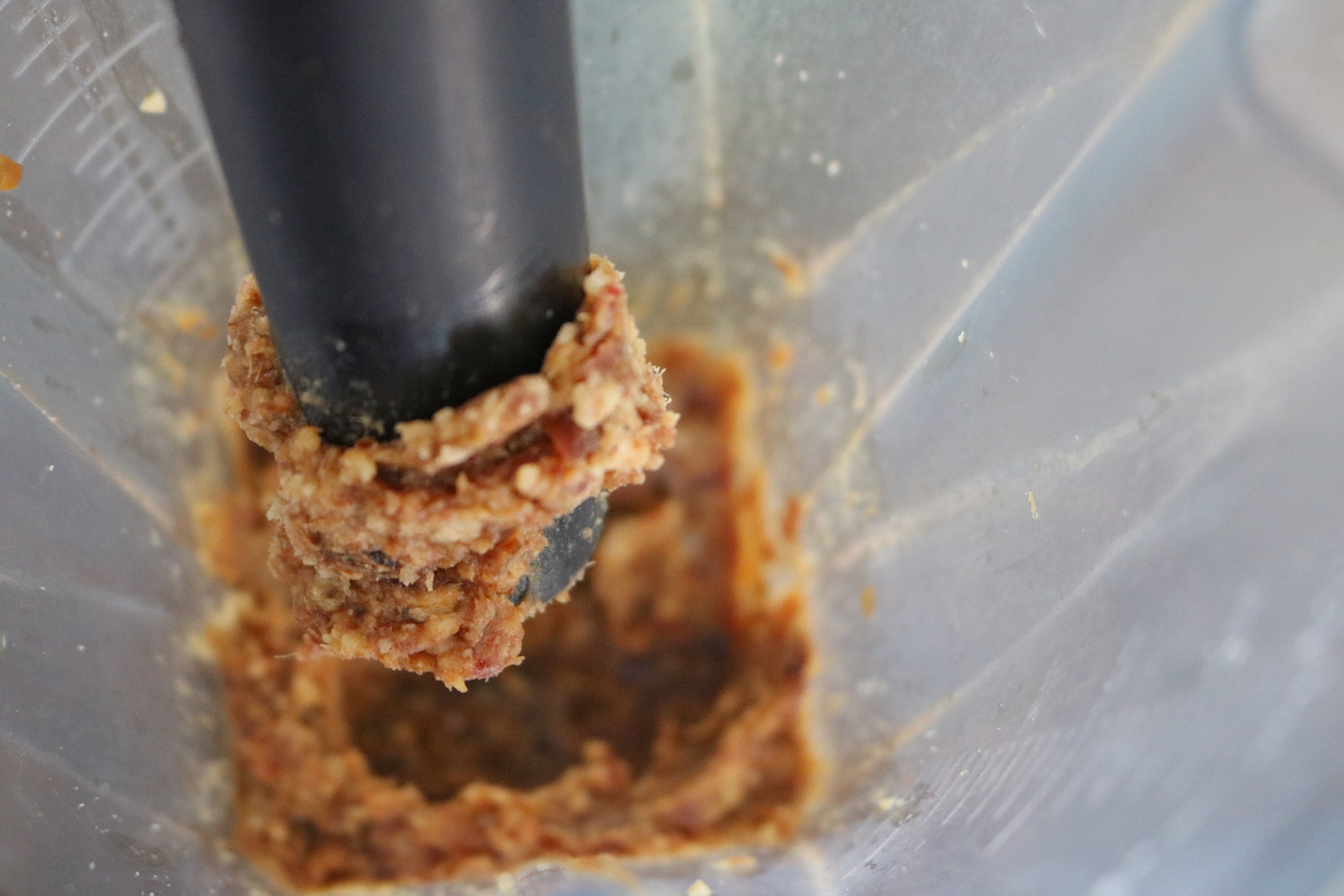 Dates and walnuts pulsed into a paste in a blender