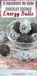 Pinterest image with text: chocolate coconut energy bits in a glass bowl with three energy balls beside the bowl and coconut around it