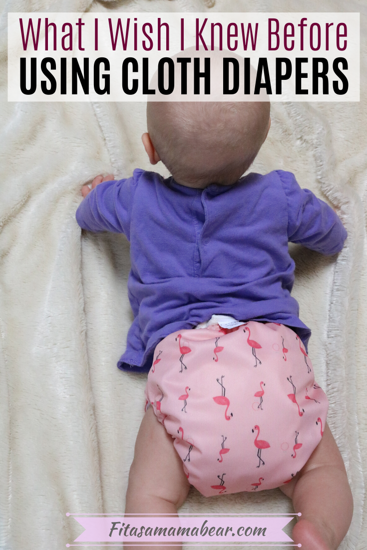 Pinterest Image with text: Baby in pink cloth diaper on a white blanket