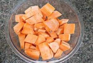 Sweet potatoes peeled, chopped and in a glass bowl