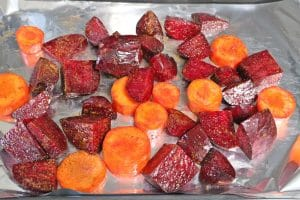 bets and carrots read to roast on baking tray