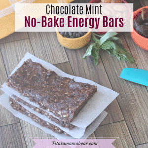 Pinterest image with text: Three chocolate, no-bake energy bars on parchment paper with ingredients behind them