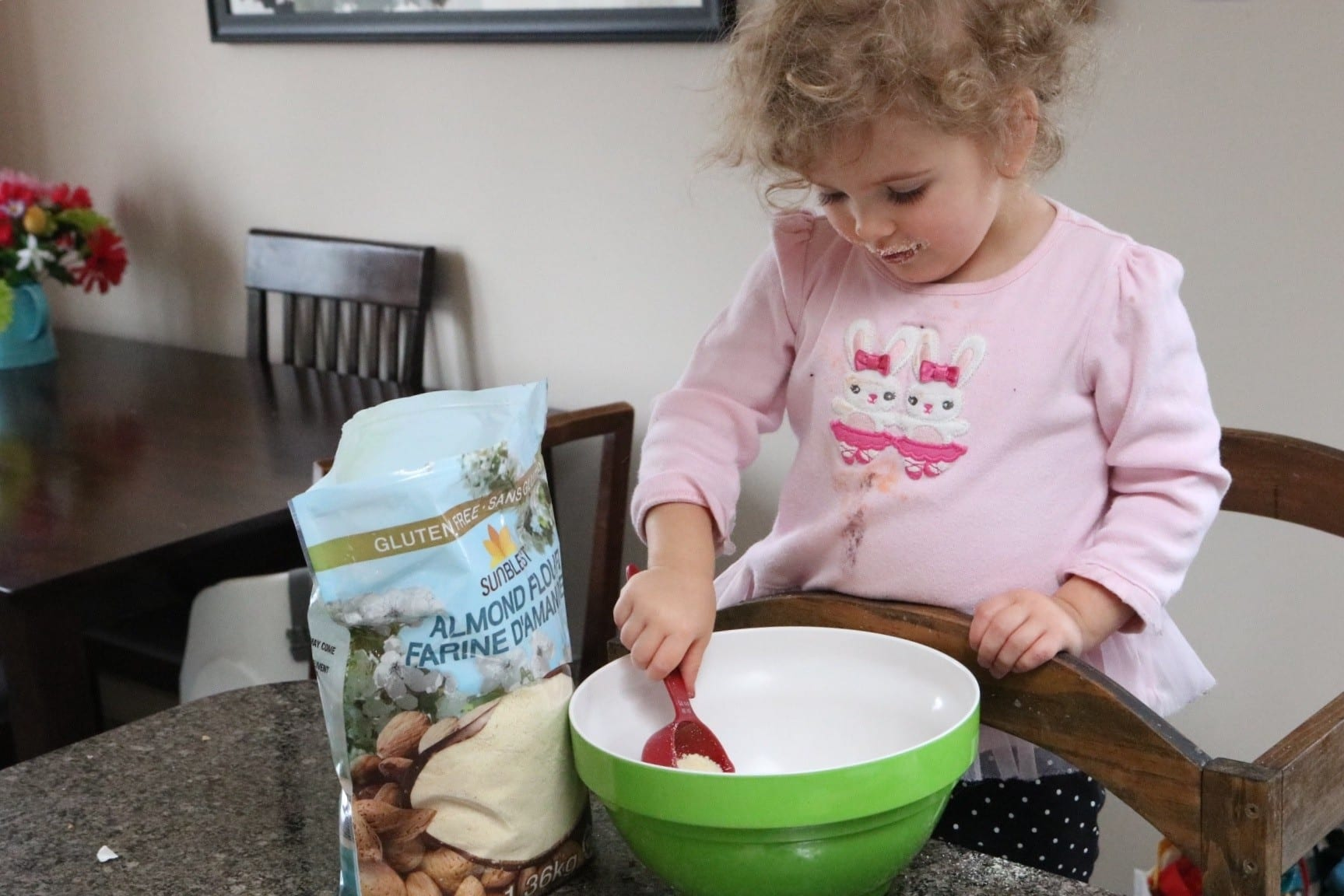 Toddler helping bake
