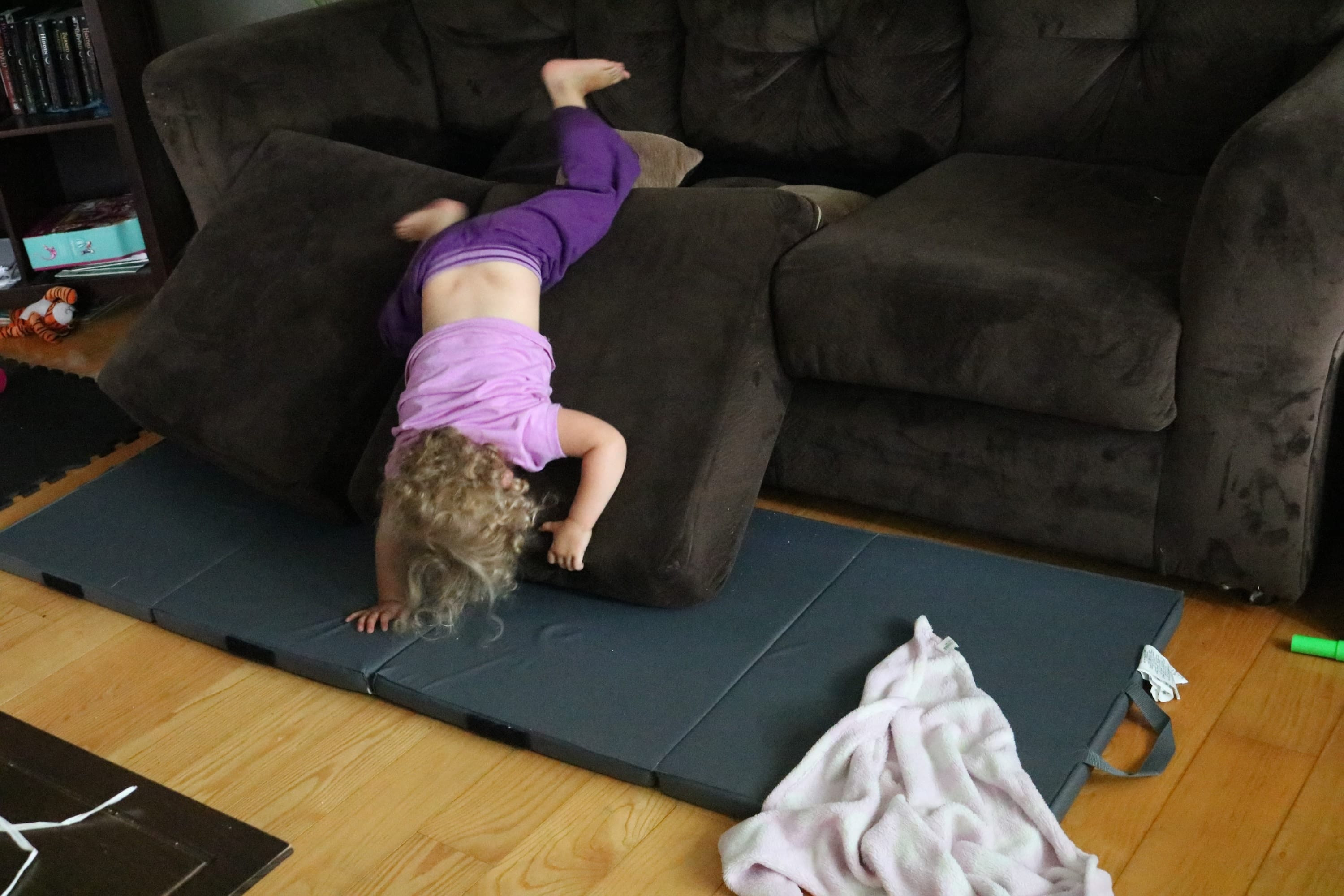 Rainy day game where a toddler is bouncing off couch