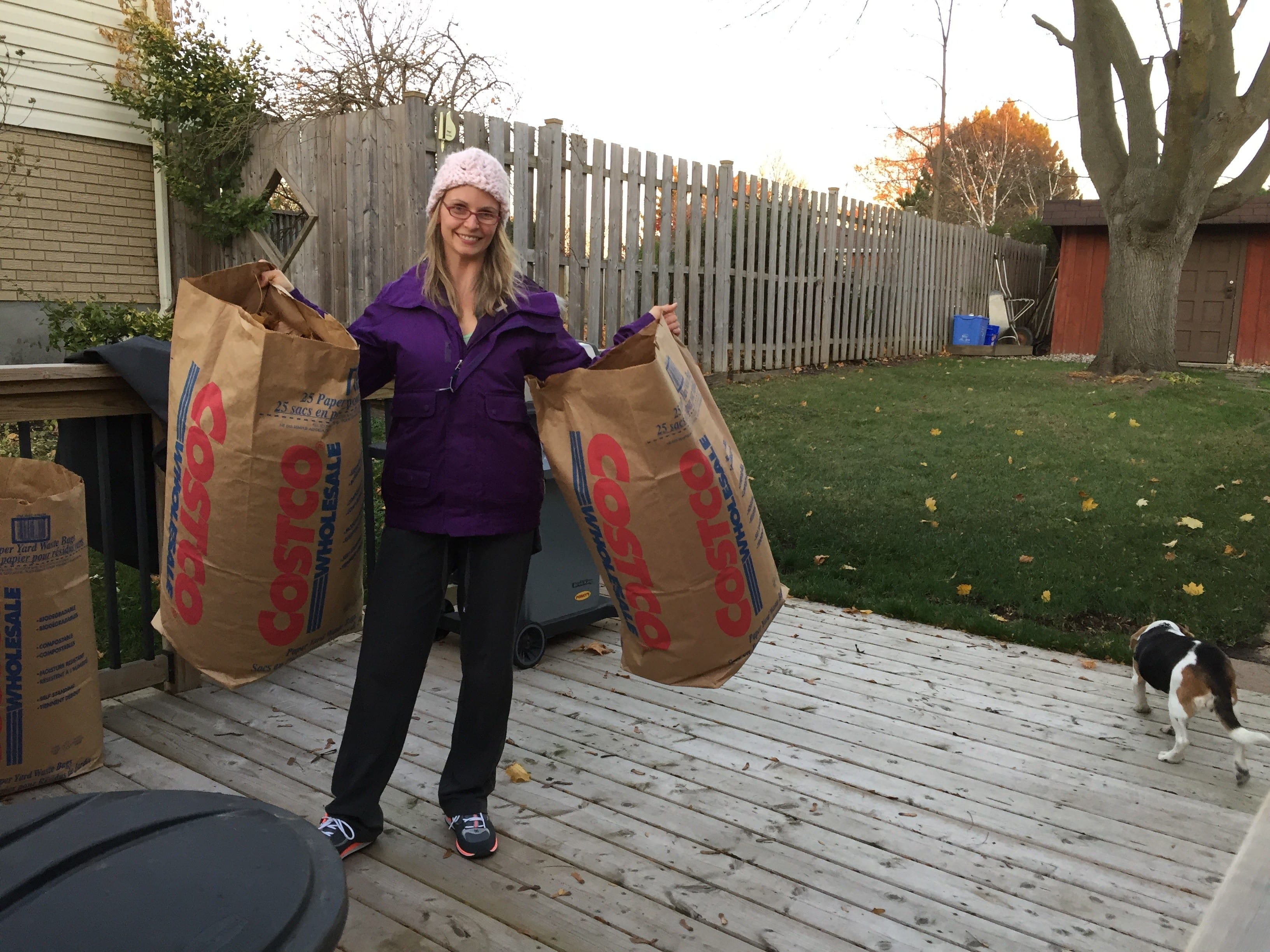 Mom holding bags of leaves