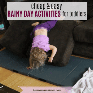 Facebook image with text: toddler in pink shirt and purple pants upside down on a couch cushion
