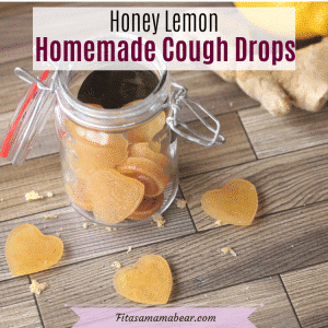 Pinterest image with text: homemade honey lemon cough drops in a mason jar with three lozanges in front and ginger root behind it