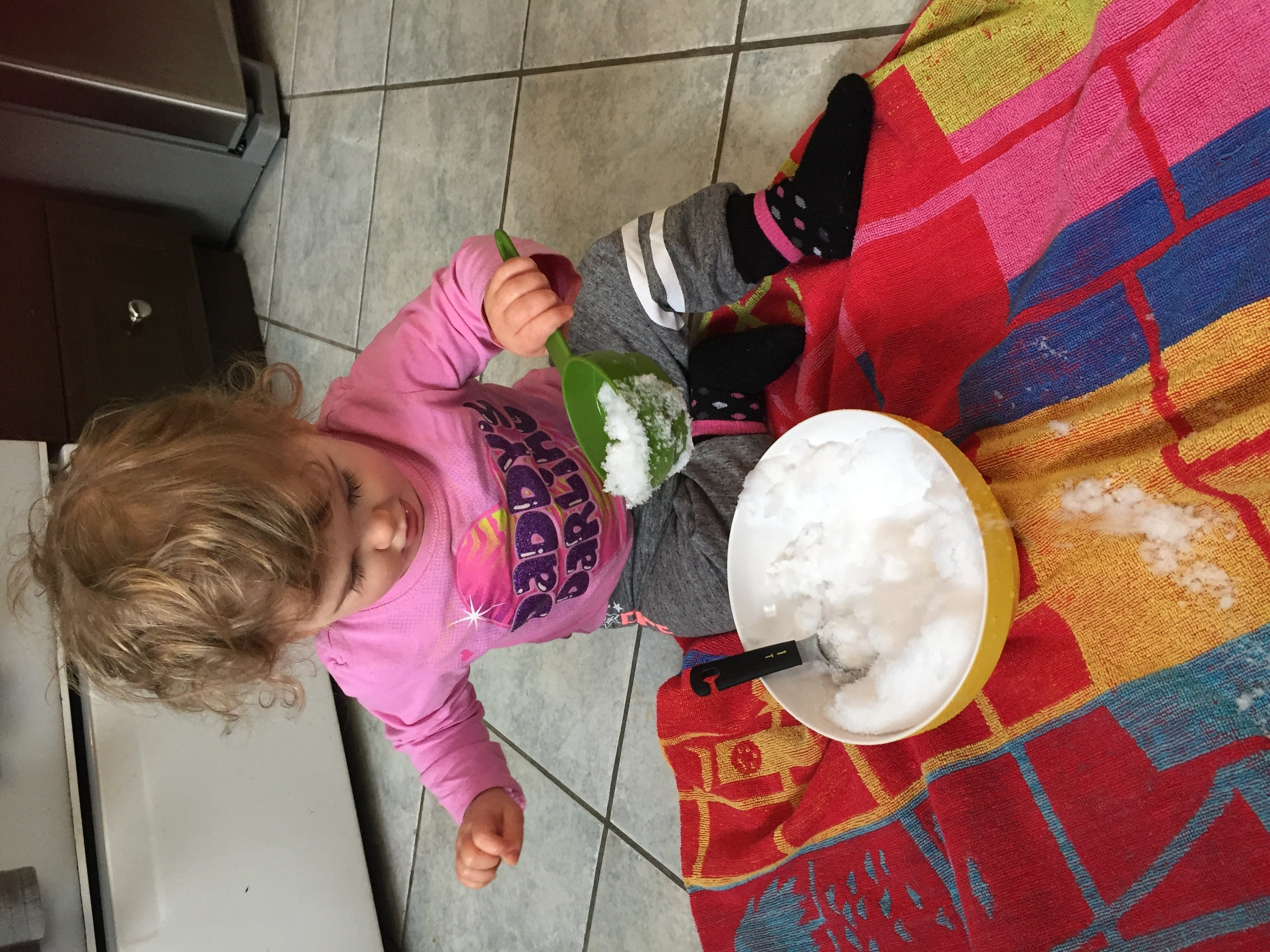 Toddler Playing With Snow