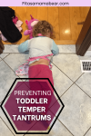 Pinterest image with text: toddler in pajamas and an apron face down on the floor crying