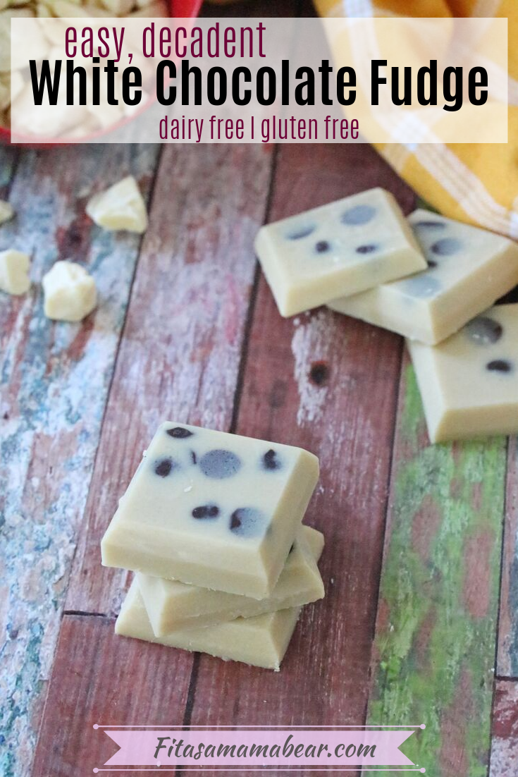 Pinterest image with text: White chocolate fudge, three squares stacked with three squares on table behind it and cacao butter falling out of a red measuring cup