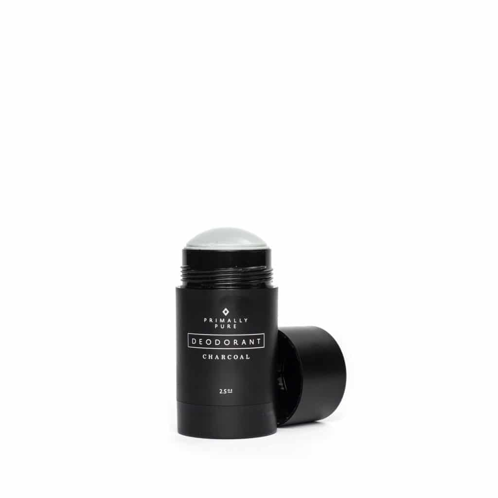 Natural charcoal deodorant in a black container