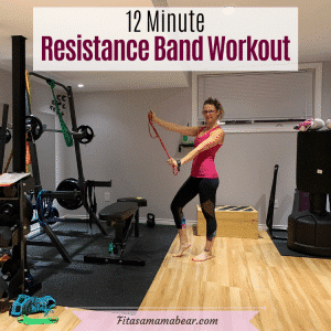 Pinterest image with text: woman in pink shirt and black pants holding a resistance band after an at home workout