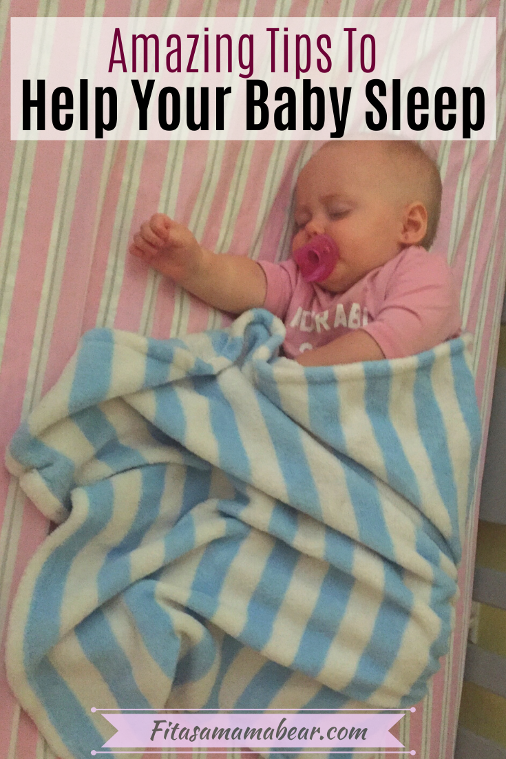 Pinterest image with text: young baby sleeping in a crib with pink sheets