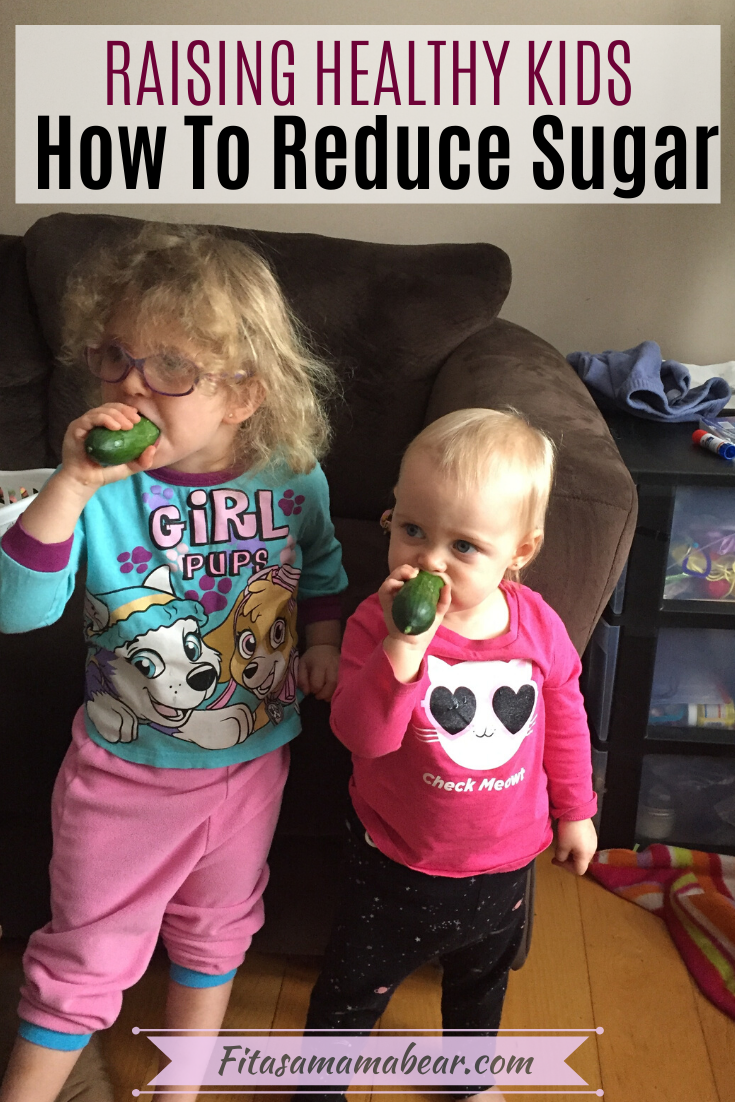 Pinterest image with text: two young children munching on cucumbers in the living room learning how to cut sugar