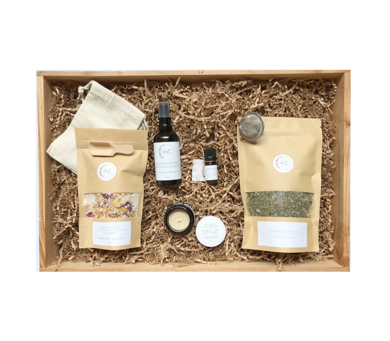 All natural products for both moms and babies in a wooden crate with shredded paper. Lotion, tea, bath salts in the box