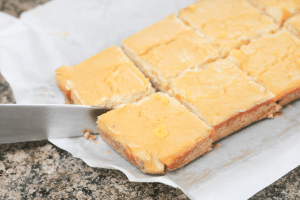 In process image for lemon bars: knife cutting cooked bars