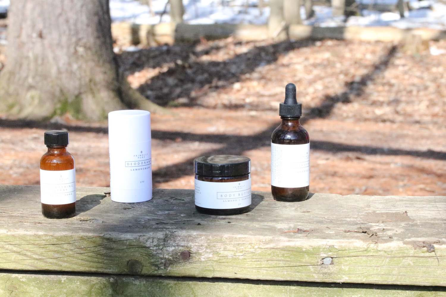 All-natural beauty products lined up outside in the forest