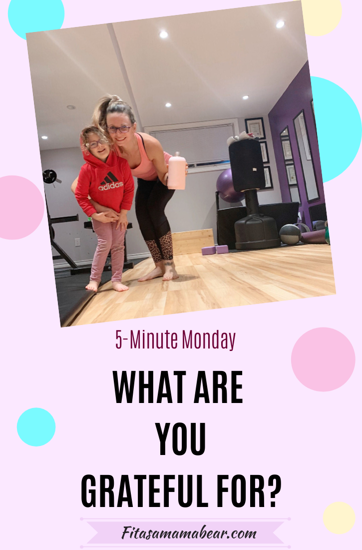 Pinterest image with text: mother and young daughter hugging in gym on a pink background with colored circles