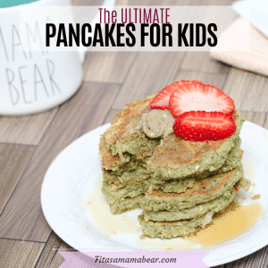 Facebook image with text: Healthy gluten-free pancakes stacked on a white plate with strawberries on top and a white mug behind it