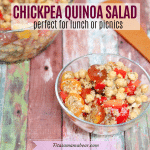 Featured image with text: Chickpea and quinoa salad with tomatoes and peppers in a glass bowl with more salad in a bowl behind it. Spatula on side.