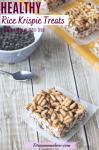 Pinterest image with text: healthy rice krispie square on parchment paper with a bowl of chocolate chips, a small spoon and more squares behind it