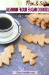 Pinterest image with text: almond flour sugar cookies in the shape of Christmas trees around a white mug of coffee on a saucer