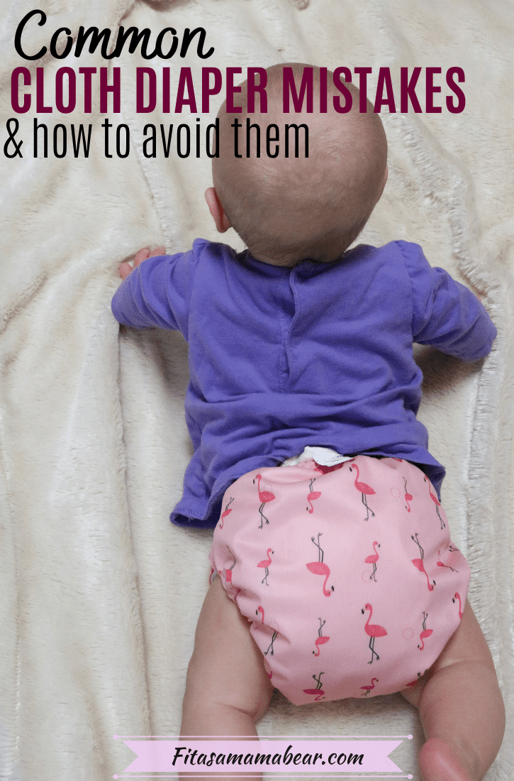 Pinterest image with text: baby in a purple shirt and a pink cloth diaper on a cloth blanket with text about cloth diaper mistakes