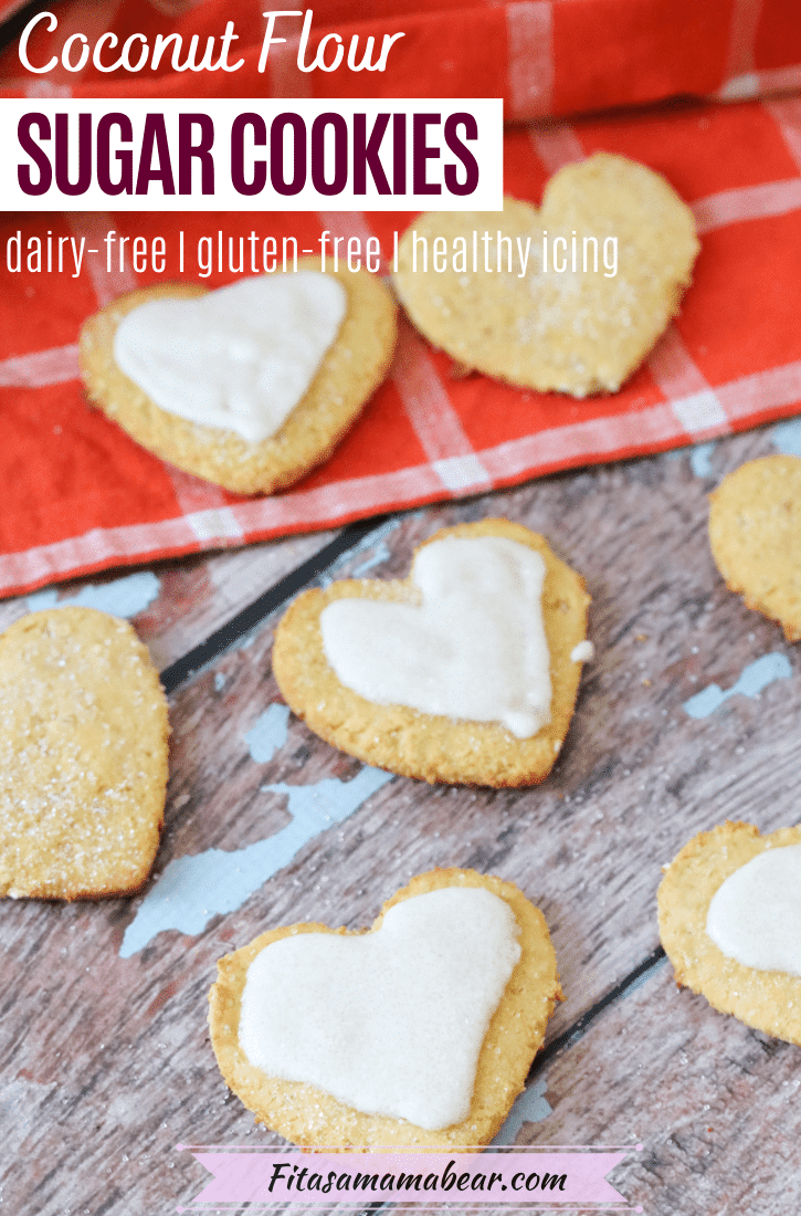 Pinterest image with text: coconut flour sugar cookies in the shape of hearts, half with white icing on an orange linen