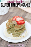 Pinterest image with text: three gluten-free pancakes stacked on a white plate with strawberries and nut butter on top. Coffee and an orange napkin behind the plate