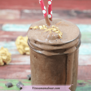 Featured image: chocolate peanut butter smoothie in a mason jar with peanut butter bomb balls and red straws in it and more balls behind it