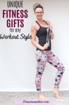 Pinterest image with text: woman in black shirt and bright pants standing holding a mini loop resistance band with text about fitness gift ideas