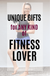 Pinterest image with text: woman in black shirt and blue shorts standing and holding a dumbbell with text about the best fitness gifts for her