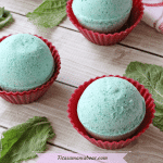 Featured image: three green bath bombs in red muffin cups with mint beside them