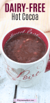 Pinterest image with text: dairy-free hot chocolate in a white and red mug that say's love on it and a light linen behind it
