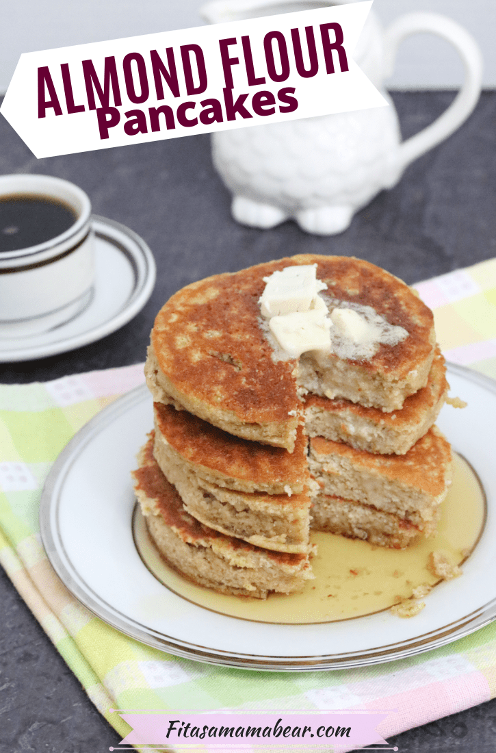 Pinterest image with text: four dairy-free pancakes stacked on a plate with syrup and butter with the plate on a colorful linen and coffee behind the plate