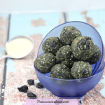 Featured image with text: superfood energy balls in two glass blue bowls stacked with collagen powder behind them and dried blueberries around them