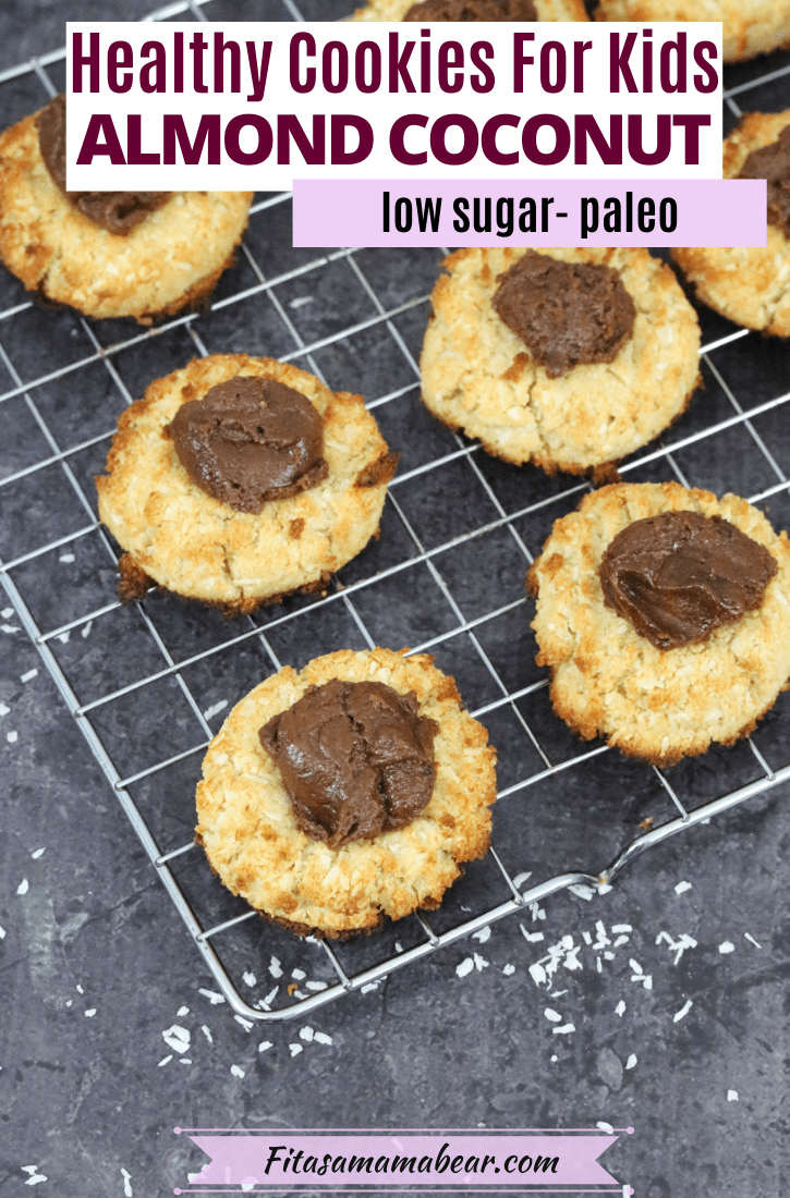 Pinterest image with text: coconut almond cookies with chocolate on a cooling rack with shredded cocnut below it