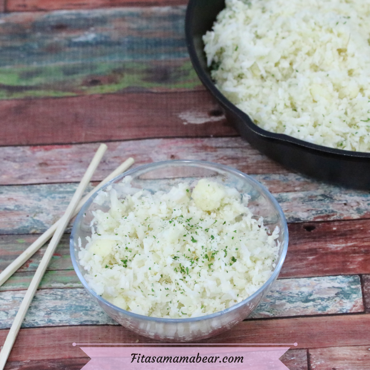 Featured image with text: glass bowl with vegan cauliflower rice and chopsticks on the side with more cauliflower rice in a pan with a wooden spoon behind it