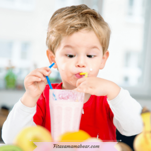Featured image with text: toddler boy in a red shirt sipping on a pink smoothie from a yellow and blue straw