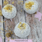 Featured image with text: three DIY herbal bath bombs with yellow flowers on top and around them