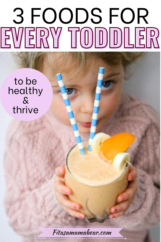 Pinterest image: toddler holding an orange smoothie with blue straws