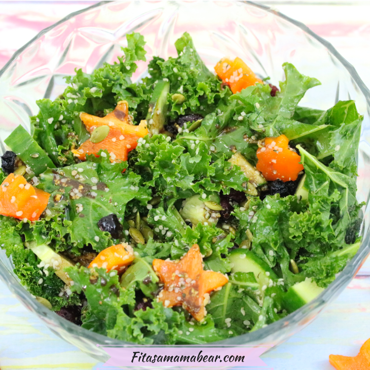 Featured image: vegan kale salad in a glass bowl with orange peppers
