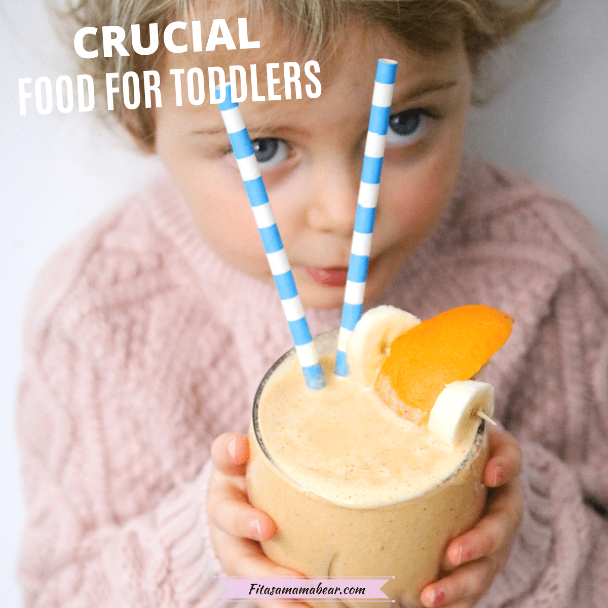 Featured image: toddler holding an orange smoothie with blue straws