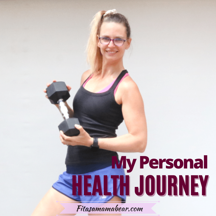 Woman in blue shorts and black tank top holding a dumbbell